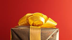 Gold Gift with Bow with Red Background