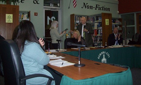 Home aurora city school district former board member beverly kuch accepts a plaque at her last board meeting december 2017 sciox Choice Image